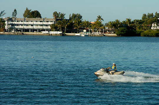 Bev Smith enjoying jet ski on the Manatee River near Tampa, Florida.
