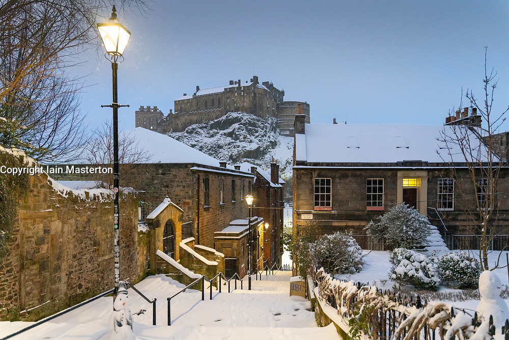 Edinburgh, Scotland, UK. 10 Feb 2021. Big freeze continues in the UK with heavy overnight and morning snow in the city. Pic; Early morning famous view from snow covered Vennel Steps towards Edinburgh Castle.  Iain Masterton/Alamy Live news