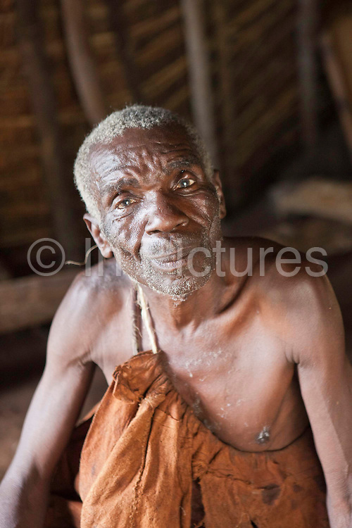 James, one of the village elders of the traditional Batwa pygmies from the Bwindi Impenetrable Forest in Uganda. They were indigenous forest nomads before they were evicted from the Bwindi Impenetrable Forest when it was made a World Heritage site to protect the mountain gorillas. The Batwa Development Program now supports them.