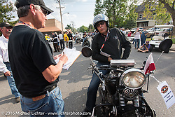 Bartek Mizerski on his 1936 Sokol 1000 Polish motorcycle arrives at check-in at the finish before the Hosted Dinner stop on Spanish Street in Cape Girardeau, Missouri during Stage 5 of the Motorcycle Cannonball Cross-Country Endurance Run, which on this day ran from Clarksville, TN to Cape Girardeau, MO., USA. Tuesday, September 9, 2014.  Photography ©2014 Michael Lichter.