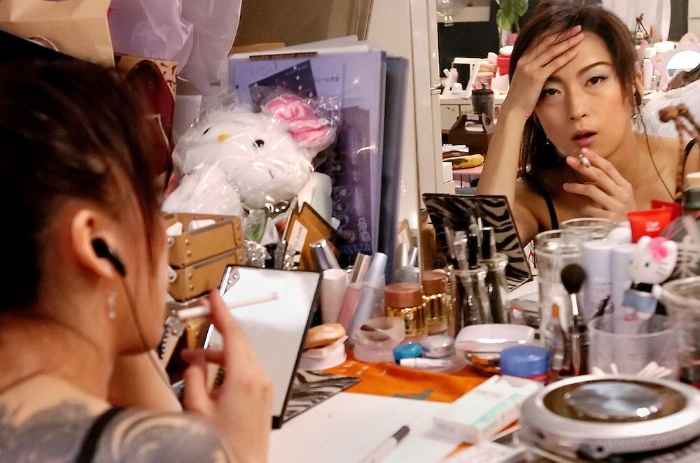 Stripper Yuki Senba rests before her show in Tokyo, Japan.