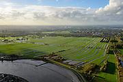 Nederland, Zuid-Holland, Ouderkerk aan den IJssel,, 23-10-2013; zicht op de Hollandse IJssel, richting Rotterdam. Weilanden gescheiden door sloten. Verkaveling. <br /> View from the river Hollandse IJssel direction Rotterdam.<br /> luchtfoto (toeslag op standaard tarieven);<br /> aerial photo (additional fee required);<br /> copyright foto/photo Siebe Swart.