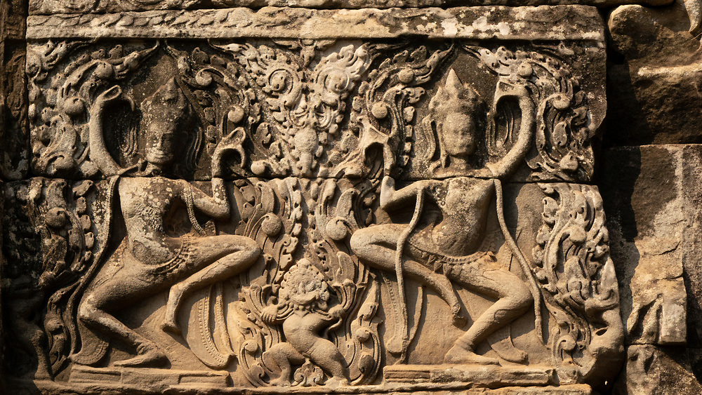 Bas-relief carving of an Aspara Dancers (heavenly nymphs) Ta Prohm temple in Angkor Wat, Siem Reap, Cambodia