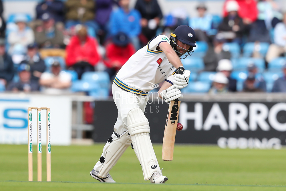 Wicket! Adam Lyth of Yorkshire nicks the ball and is caught by Joe Weatherley of Hampshire off the bowling of Keith Barker of Hampshire during the opening day of the Specsavers County Champ Div 1 match between Yorkshire County Cricket Club and Hampshire County Cricket Club at Headingley Stadium, Headingley, United Kingdom on 27 May 2019.