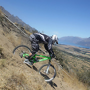 Ashley Ruth from Christchurch in action during the New Zealand South Island Downhill Cup Mountain Bike series held on The Remarkables face with a stunning backdrop of the Wakatipu Basin. 150 riders took part in the two day event. Queenstown, Otago, New Zealand. 9th January 2012. Photo Tim Clayton