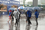 © Licensed to London News Pictures. 07/06/2014. Epsom, UK. A thunder storm causes workers and guest to run for cover. Derby Day today 7th June 2014 at Epsom 2014 Investic Derby Festival in Surrey. Traditionally, elegant, fashionable racegoers gather for a classic day's racing at Epsom Racecourse, Surrey. Photo credit : Stephen Simpson/LNP