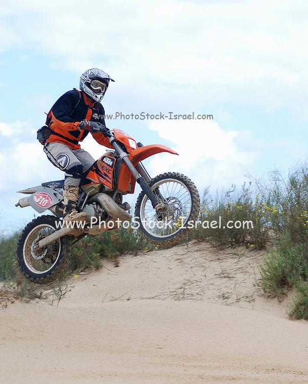 Israel, Caesarea, Off track motorbike racing, in the sand dunes near the beach