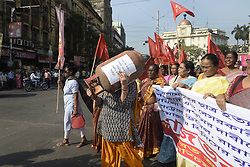 October 4, 2018 - Kolkata, West Bengal, India - Woman activist carry LPG cylinder during the march to Governor House to protest against fuel price hike. Activist of All Indian Agragami Mahila Samity or AIAMS take part in a march to Governor House to protest against fuel price hike and other issue. (Credit Image: © Saikat Paul/Pacific Press via ZUMA Wire)