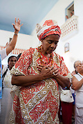 Bahiana tradtionally dressed woman. Often the lines between Candomble and Catholicism are blurred. This is especially true with the Sao Lazaro event in late January in Salvador, Bahia, Brazil, the city which is known as the home of Candomble. Sao Lazaro represents healing and the sick.