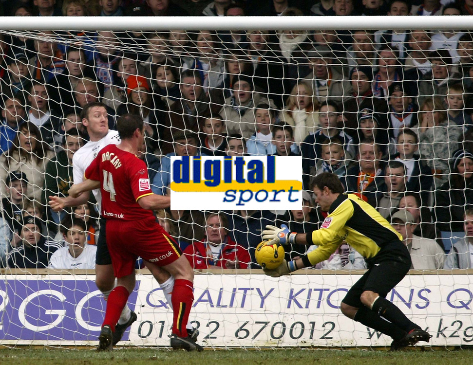 Photo: Chris Ratcliffe.<br />Luton Town v Watford. Coca Cola Championship.<br />02/01/2006.<br />Malkay Mackay (L) forces the ball past Marlon Beresford in the Luton goal. Beresford stops it but the ref, I Williamson adjudges that it goes over the line.