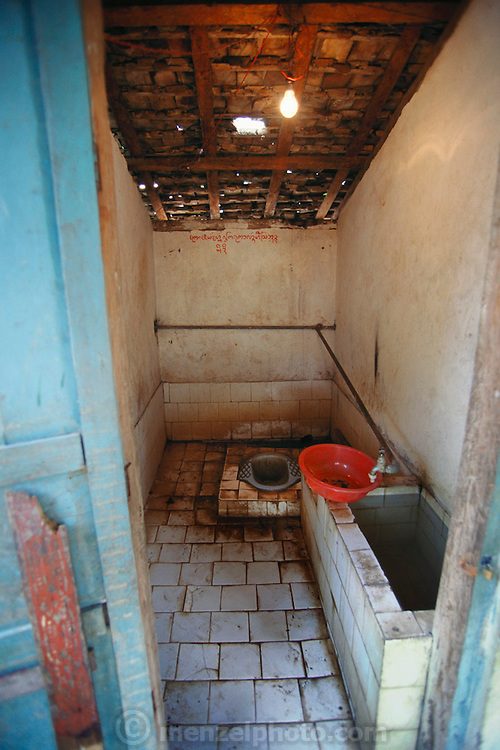 Monks' squat toilet at the Golden Temple outside Jinghong, Xishuangbanna, China.