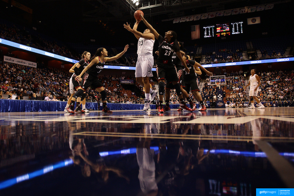 Kaleena Mosqueda-Lewis, UConn, shoots while defended by Jasmine Whitfield, Cincinnati, during the UConn Vs Cincinnati Quarterfinal Basketball game at the American Women's College Basketball Championships 2015 at Mohegan Sun Arena, Uncasville, Connecticut, USA. 7th March 2015. Photo Tim Clayton