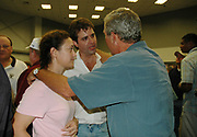 President Bush hugs the mayor of Gulfport Brent Warr nad his wife laura  after his remarks at the Pearl River Community College in Poplarville Ms. Monday Sept. 5,2005. Hurricane Katrina is the worst natural disaster to hit American soil and the National and local goverments are working together to clean up the mess from the catasrophic destruction. (Photo/Suzi Altman)