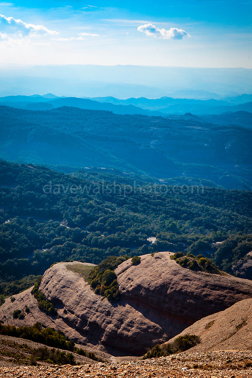 View from the 1056 metre high mountain of Montcau, in the Parc Natural Sant Llorenc del Munt massif, near Barcelona, Catalonia. 1056 metre high mountain of Montcau, in the Parc Natural Sant Llorenc del Munt massif, near Barcelona, Catalonia.