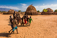 A group of Arbore tribe boys walking arm in arm in their village, Omo Valley, Ethiopia.