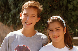 Portrait of teenage boy and girl smiling,