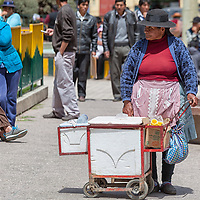 An elderly woman selling ice creams at  Plaza de Armas in Pampas also known as Pampa Tayacaja.