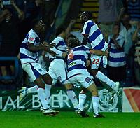 Photo: Daniel Hambury.<br />Queens Park Rangers v Leeds United. Coca Cola Championship. 08/08/2006.<br />QPR's players mob goal scorer Shabazz Baido (far right) who scored to make it 2-2.