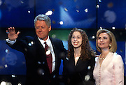 U.S President Bill Clinton hugs daughter Chelsea and wife Hillary Rodham Clinton as confetti falls after accepting the nomination for the democrat party at the 1996 Democratic National Convention August 29, 1996 in Chicago, IL.