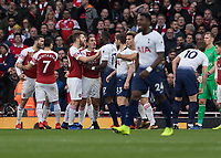 Football - 2018 / 2019 Premier League - Arsenal vs. Tottenham Hotspur<br /> <br /> Moussa Sissoko (Tottenham FC)  involved with Shkodran Mustafi (Arsenal FC) after Arsenal concede a penalty at The Emirates.<br /> <br /> COLORSPORT/DANIEL BEARHAM