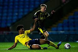 Kieran Phillips of Bristol Rovers is fouled by Nico Jones of Oxford United - Mandatory by-line: Robbie Stephenson/JMP - 06/10/2020 - FOOTBALL - Kassam Stadium - Oxford, England - Oxford United v Bristol Rovers - Leasing.com Trophy