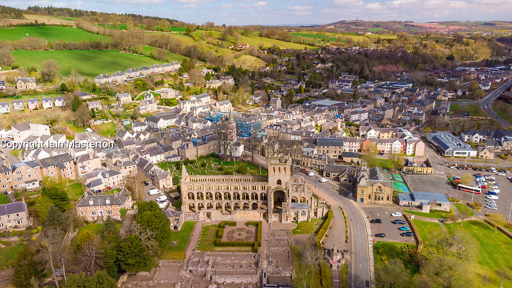 Aerial view from drone of Jedburgh Abbey ( closed during lockdown) and town in Jedburgh, Scottish Borders, Scotland, UK