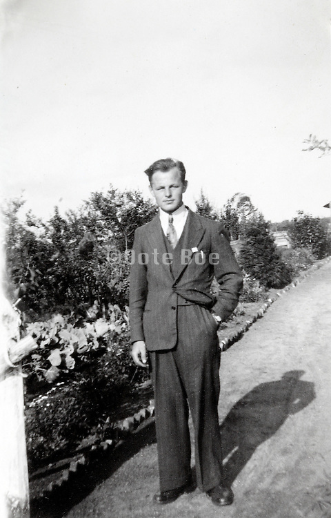 young adult man posing outside Netherlands 1940s
