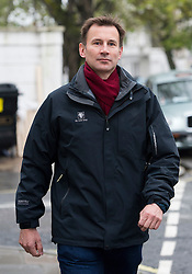 © London News Pictures. 28/04/2012. London, UK. Secretary of State for Culture, Olympics, Media and Sport Jeremy Hunt MP leaving his home in Pimlico, West London on April 28, 2012. Hunt has pledged to hand over all private emails  and text messages about the News Corp bid for BskyB to the Leveson Inquiry. Photo credit : Ben Cawthra /LNP