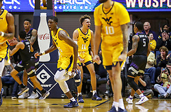 Feb 18, 2019; Morgantown, WV, USA; West Virginia Mountaineers forward Emmitt Matthews Jr. (11) celebrates after a dunk during the first half against the Kansas State Wildcats at WVU Coliseum. Mandatory Credit: Ben Queen-USA TODAY Sports