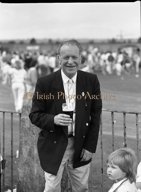 """Guinness Family Day At The Iveagh Gardens. (R83)..1988..02.07.1988..07.02.1988..2nd  July 1988..The family fun day for Guinness employees and their families took place at the Iveagh Gardens today. Top at the bill at the event were """"The Dubliners"""" who treated the crowd to a performance of all their hits. Ireland's penalty hero from Euro 88, Packie Bonner, was on hand to sign autographs for the fans...A pint is the order of the day for this gentleman as he takes a break during the family day outing at Iveagh Gardens in Dublin."""