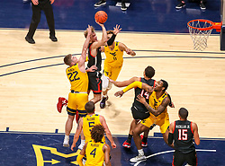 Jan 25, 2021; Morgantown, West Virginia, USA; Texas Tech Red Raiders guard Mac McClung (0) shoots against West Virginia Mountaineers guard Sean McNeil (22) during the second half at WVU Coliseum. Mandatory Credit: Ben Queen-USA TODAY Sports