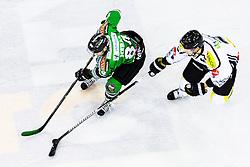 3.01.2014, Hala Tivoli, Ljubljana, SLO, EBEL, HDD Telemach Olimpija Ljubljana vs Dornbirner Eishockey Club, 63rd Game Day, in picture Andrej Hebar (HDD Telemach Olimpija, #84) vs Olivier Magnan-Grenier (Dornbirner Eishockey Club, #2) during the Erste Bank Icehockey League 63rd Game Day match between HDD Telemach Olimpija Ljubljana and Dornbirner Eishockey Club at the Hala Tivoli, Ljubljana, Slovenia on 2014/01/03. (Photo By Matic Klansek Velej / Sportida)