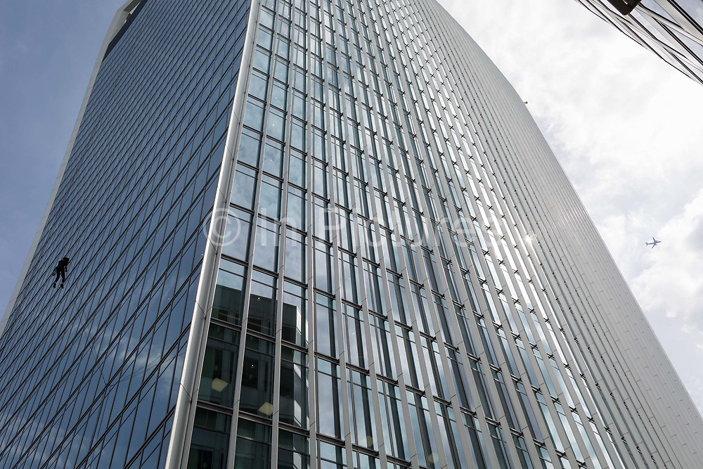 A brave but confident cleaning contractor abseils from 20 Fenchurch Street aka the Walkie Talkie building in the capitals oldest financial district aka The Square Mile, on 14th August 2017, in the City of London, England.