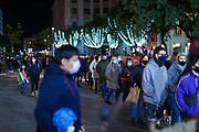 People wearing surgical face protective masks cruise across the city centre of Barcelona, on Sunday, Dec 6, 2020. Due to the regional way in which Spain is governed, there has been more variety in how the country responded to the pandemic. The region of Catalonia - in the north-east of the country - announced it would not relax the restrictions in the area on Monday. The administration in the region put off the re-opening by a week, forcing ski resorts to also put back their reopening dates. Figures were on a downward trend until the hospitality sector reopened on 23 November, according to Catalan health secretary Josep Argimon. Spain has seen 1,684,647 coronavirus cases and 46,252 deaths. (VXP Photo/ Vudi Xhymshiti)