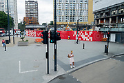 The changing urban landscape of the former Elephant & Castle shopping centre which is being demolished and redeveloped in south London, on 15th July 2021, in London, England. The much-criticised architecture of the Elephant & Castle Shopping Centre was opened in 1965, built on the bomb damaged site of the former Elephant & Castle Estate, originally constructed in 1898. The centre was home to restaurants, clothing retailers, fast food businesses and clubs where south Londoners socialised and met lifelong partners.