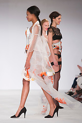© Licensed to London News Pictures. 01/06/2014. London, England. De Montfort Contour fashion show, collection by Karolina Laskowska. Graduate Fashion Week 2014, Runway Show at the Old Truman Brewery in London, United Kingdom. Photo credit: Bettina Strenske/LNP