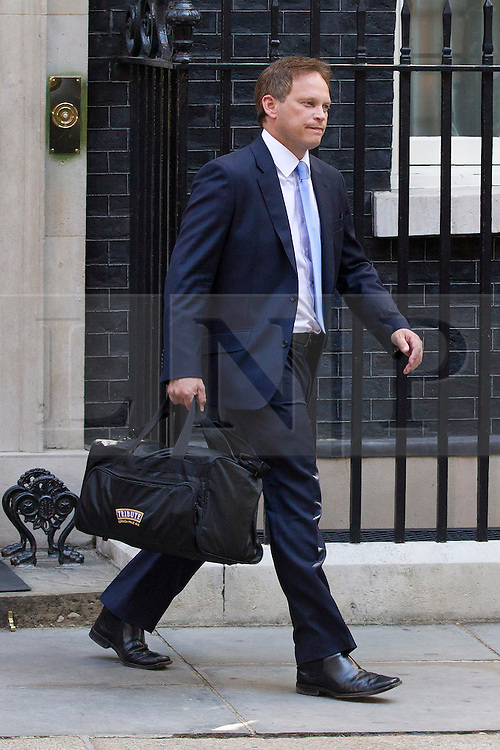 "© Licensed to London News Pictures. 29/08/2013. London, UK. Conservative Chairman Grant Shapps leaves a meeting of the British cabinet on Downing Street in London today (29/08/2013) as a recalled British Parliament prepares to debate the possibility of ""direct"" military action over recent reports an alleged chemical weapons attack in Syria. Photo credit: Matt Cetti-Roberts/LNP"