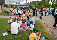 Woodland Heights Elementary students, faculty and parents enjoyed a BBQ'd Cookout and Read In on the lawn served by Laconia Fire and Police Friday afternoon.   (Karen Bobotas/for the Laconia Daily Sun)