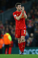 James Milner of Liverpool applauds the fans after the game. Premier League match, Liverpool v West Ham Utd at the Anfield stadium in Liverpool, Merseyside on Sunday 11th December 2016.<br /> pic by Chris Stading, Andrew Orchard sports photography.