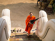 07 APRIL 2013 - CHIANG MAI, CHIANG MAI, THAILAND: A Buddhist Monk walks into the prayer hall at Wat Jetlin in Chiang Mai, Thailand. Chiang Mai is the largest town in northern Thailand and is popular with tourists and backpackers.       PHOTO BY JACK KURTZ