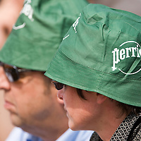 04 June 2007: Two viewers wear a Perrier hat during the French Tennis Open fourth round match won 6-3, 6-1, 7-6 (7/5) by Rafael Nadal over Lleyton Hewitt on day 9 at Roland Garros, in Paris, France.