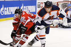 24.04.2010, Eishalle, IJssportcentrum, Tilburg, NED, IIHF Division I WM, Gruppe A, Österreich vs Niederlande im Bild Daniel Welser and Diederick Hagemeijer battle for the puck, EXPA Pictures © 2010, PhotoCredit/ EXPA/ Fintan Planting / SPORTIDA PHOTO AGENCY