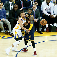 01 June 2017: Golden State Warriors guard Stephen Curry (30) passes the ball over Cleveland Cavaliers guard Kyrie Irving (2) during the Golden State Warriors 113-90 victory over the Cleveland Cavaliers, in game 1 of the 2017 NBA Finals, at the Oracle Arena, Oakland, California, USA.