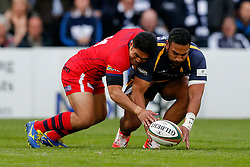 Bristol Rugby Winger David Lemi is beaten to the ball by Worcester Winger Cooper Vuna - Photo mandatory by-line: Rogan Thomson/JMP - 07966 386802 - 27/05/2015 - SPORT - Rugby Union - Worcester, England - Sixways Stadium - Worcester Warriors v Bristol Rugby - Greene King IPA Championship Play-Off Final 2nd Leg.