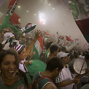 Fluminense fans throw rice powder as their team take the field before the Fluminense V Sao Paulo, Futebol Brasileirao  League match at the Jornalista Mário Filho Maracana Stadium, The fans have a tradition of throwing rice powder as the team takes the field in honour of Carlos Alberto, a player of mixed race ethnicity who, in 1914, attempted to lighten his skin by covering himself in rice powder on debut for his team. Unfortunately his sweat washed the powder off during the match and he was jeered by the opposing supporters..Rio de Janeiro,  Brazil. 29th August 2010. Photo Tim Clayton.