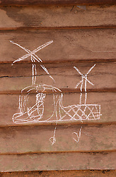 Drawings on the wall of houses in Naver village, Dakcheung, near Sekong, Lao PDRDrawings on the wall of houses in Naver village, Dakcheung, near Sekong, Lao PDR