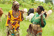 Maria Mchele (R) and Mwanaidi Ramadhani stand in a field near the sweet potato farm where they work in the village of Mwazonge, roughly 30km southwest of Mwanza, Tanzania on Sunday December 13, 2009...