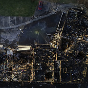 An aerial view from a drone of an apartment building that caught fire yesterday on the 5900 block of Cresthaven Lane in Toledo on Thursday, April 1, 2021. THE BLADE/KURT STEISS