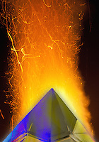 blue crystal pyramid peak on fire flame in red collor with yellow shades on black background