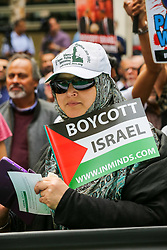 © Licensed to London News Pictures. 02/06/2019. London, UK. Protesters take part in the annual Al Quds day protest and march from Home Office to Whitehall in central London. Al-Quds Day, an annual day of protest decreed in 1979 by the late Iranian ruler Ayatollah Khomeini, is celebrated to express support for the Palestinian people and their resistance against Israeli occupation. Photo credit: Dinendra Haria/LNP